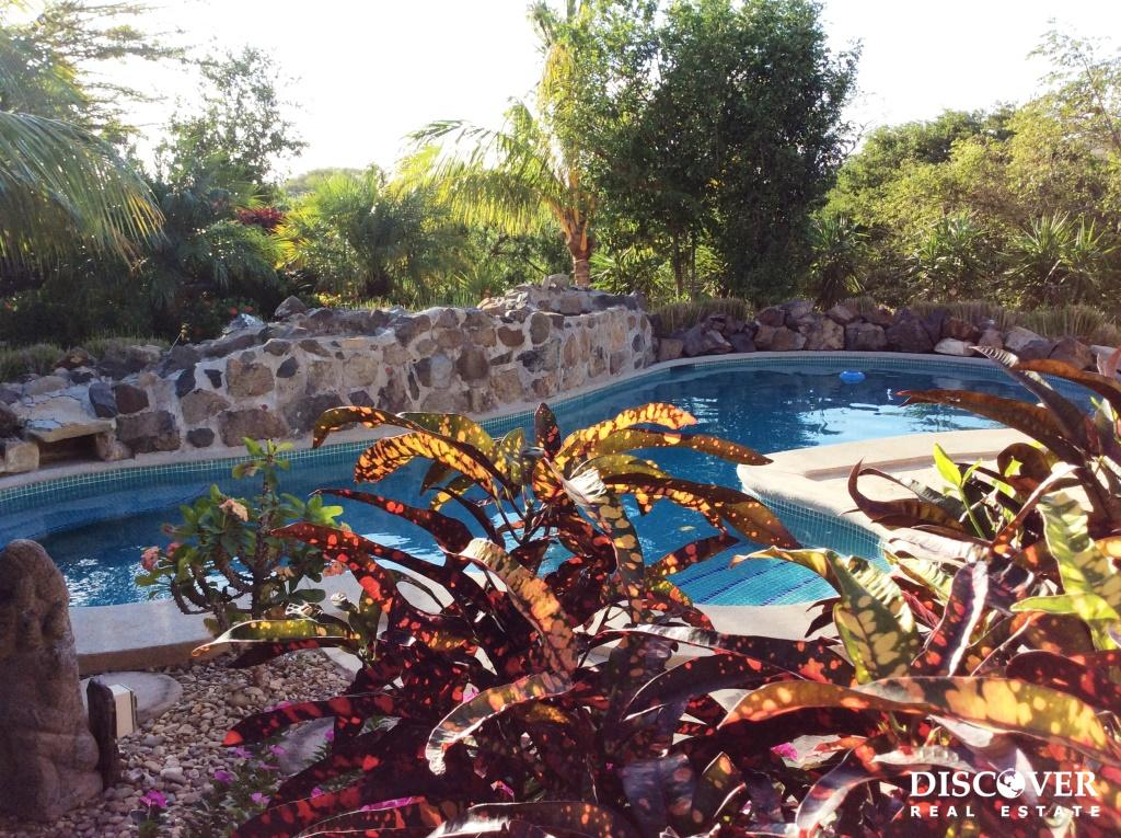 Two-bedroom house with a great pool and garden spaces for only $212,000!